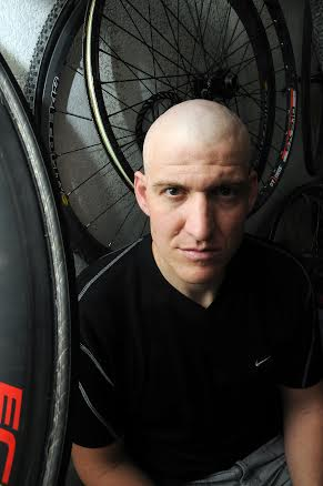 Robin Zielinski – Sun-NewsMichael Barrow, 37, who has Multiple Sclerosis, is surrounded by bicycle wheels in the garage of his home on Wednesday -- cycling and dirt-bike riding has been a source strength and comfort for Barrow while living with the disease. Barrow was recently accepted into Northwestern University's stem cell transplant program to replace his immune system. The transplants offer patients a first-ever MS treatment that has been found to reverse the disability.